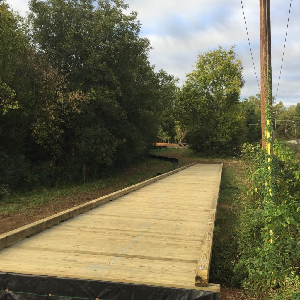 OCTOBER 2019: Construction team place a boardwalk ramp at the corner of Roddey and Colonial Drive.
