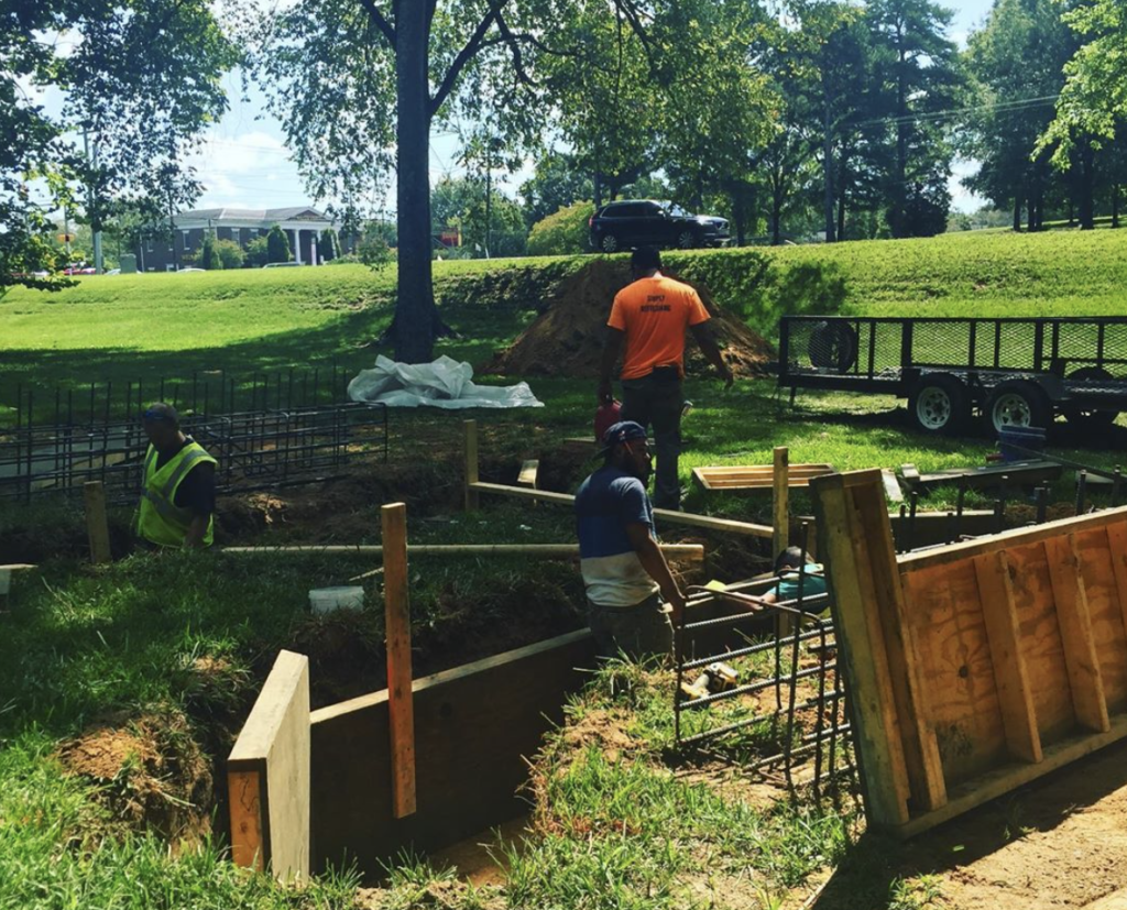 SEPTEMBER 2019: Construction team creating a swail bridge to channel water flow to Gills Creek.